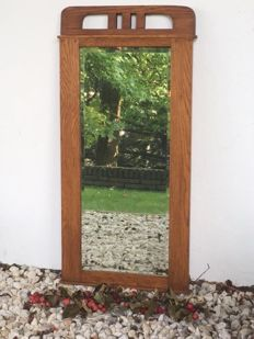 Facet cut middle brown oak mirror from grandmother's time, ca. 1930