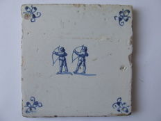 Antique tile with 2 archers