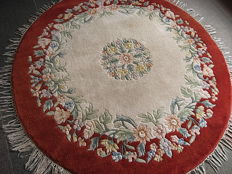 A beautiful floral-knotted made rug, India, dia. 155