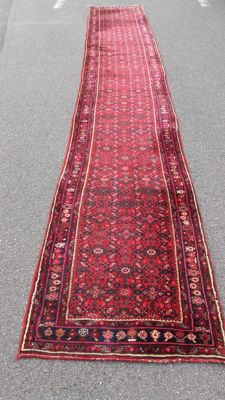 Beautiful olde hand-knotted Persian Loper, 604 x 87 cm.
