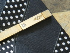 Ford vintage tie pin in 18kt yellow gold with 0.05 ct diamond
