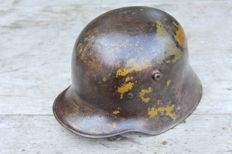German steel helmet model 1916 with signs of camouflage colours. Chinstrap is missing.