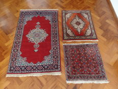 Three Persian carpets, approx. 149 x 91 cm 88 x 75 cm and 70 x 70 cm