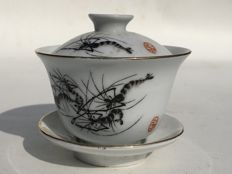 Porcelain teacup with cover depicting shrimps and red seal - China - late 20th century