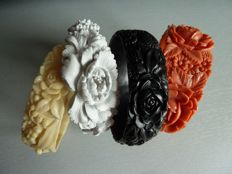 Collection of 4 old bracelets made of moulded celluloid, white, coral, black and pale yellow, with chrysanthemums and roses patterns