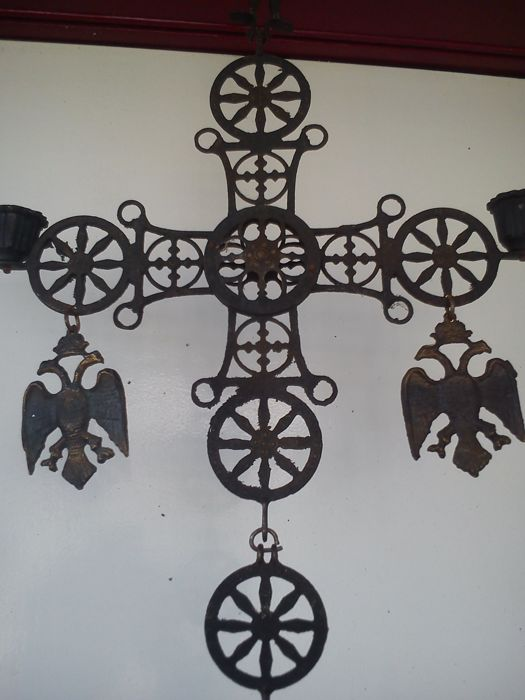 Antique cross in the shape of candle holder.