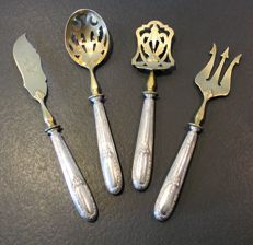 Four silver hors d'oeuvre serving utensils, Minerva's head, in their original case - France - late 19th century