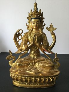 Representation of Chenrezig in gold patinated copper – Nepal – early 21st century.