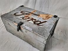 Ancient workshop-garage box with metallic FORD emblem on the lid