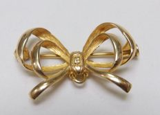 Brooch in bow shape and 18 kt Gold