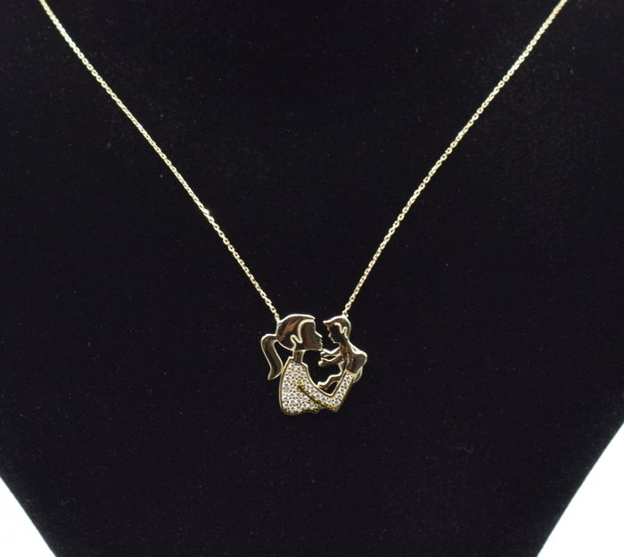 14 carat yellow gold necklace with baby pendant