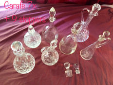 Collection of 7 Crystal Carafe with stoppers (2 extra).