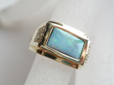 375 gold ring with boulder opal and diamond
