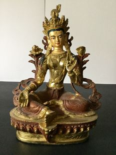 Depiction of Green Tara in copper with gold and brown patina - Nepal - early 21st century