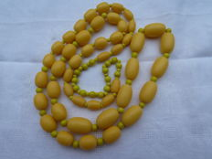 Long Art deco necklace  made of Bakelite and glass beads spacers