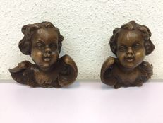 Two wooden angel heads - presumably Germany - early 20th century