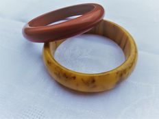 Two bangles made of tested Bakelite including a Mississippi Mud
