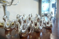 12 Silver plated napkin ring in the shape of a swan and beautiful sconce with 5 lights