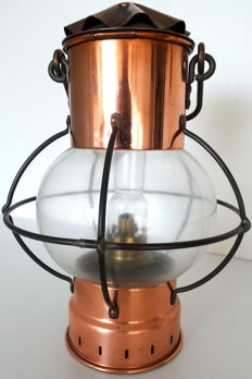 Antique brass ship's lamp of red copper.