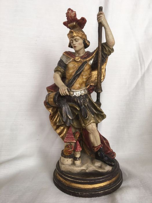 Polychrome and gilt painted hand carved wooden statue of a Roman Warrior