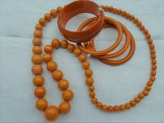 Very nice lot of four bangles and a tested butterscotch Bakelite necklace