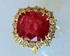 Gold ring with big ruby & diamonds.