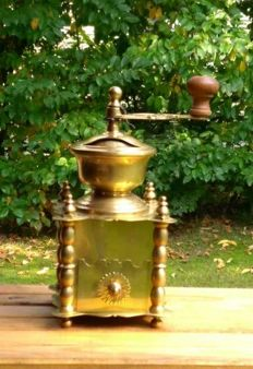 Solid yellow brass coffee grinder with daisies