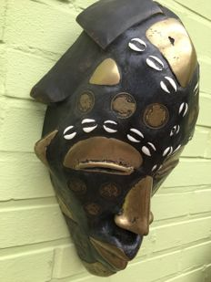 African coin mask - Cameroon