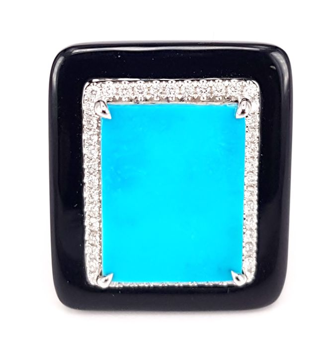 9.97 cts Turquoise flanked by 0.33 cts White Diamond and 6.3 cts Onyx RIng in 18kt White Gold