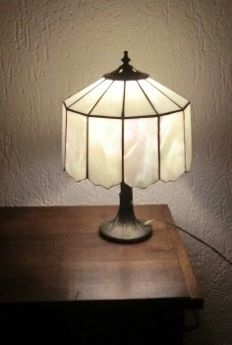 Bronze table or desk lamp in the shape of a tree trunk and stained glass lamp shade like mother of pearl