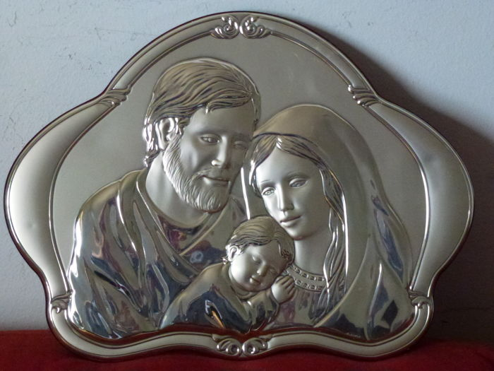 Christian-Catholic - Silver (24 g) - plate to hang behind the bed with icons of the Holy Family on wooden frame; double positioning: wall mounting with a hole on the back; set on a piece of furniture with a support on the back - Italy, Ancora 21st century