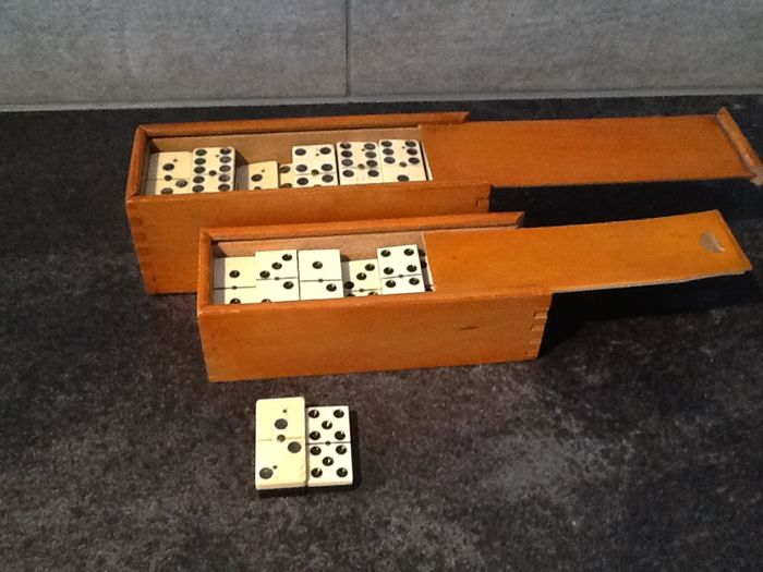 2 Antique wooden boxes each holding 28 dominoes of bone and ebony