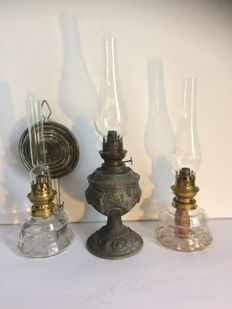 Three oil lamps, including one of zamac - circa 1920