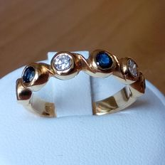 18K gold ring with blue sapphires and diamonds