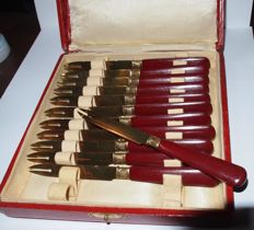12 cocktail forks in box marked Luce Paris.