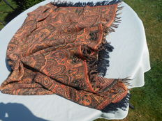 Table cloth with a beautiful pattern in warm colours