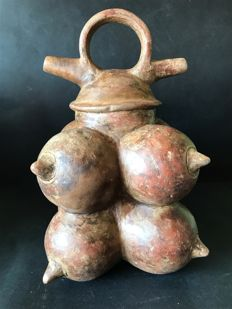 Original ceramic pre-Columbian archaeological find  in Cauca medio region -Colombia  Poporo consists of eight round shapes each of which represents a feminine breast Dimensions : 25 cm x 19 cm
