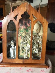 A chapel with a bridal bouquet and a porcelain doll inside, early 20th century