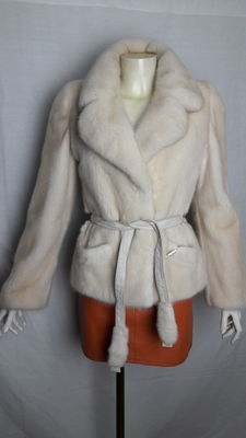 Pearl-coloured mink coat.