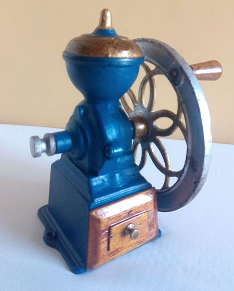 Antique coffee and spice wheel grinder, 1930