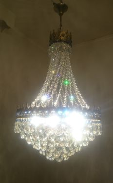 A brass and crystal chandelier, of recent manufacture