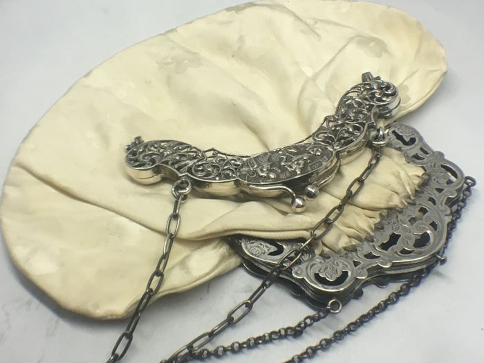 Two silver purse braces, a.o. a parrot clasp, The Netherlands, 19th/20th century
