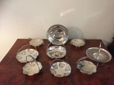 9 silver plated bon bon dishes with open work decoration.