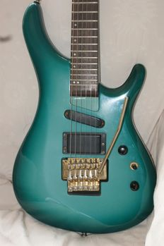 Aigion REC280GD superstrat in beautiful green burst, one of the small series guitar built by Belgian guitar builder