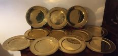 11 heavy gold plated decorative plates.