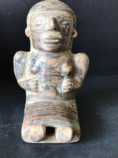 Ceramic pre-Columbian archaeological find Altoplano narinese  Pasto – Colombia.  Female anthropomorphic figure sitting.   Dimensions: 190mm / 160mm