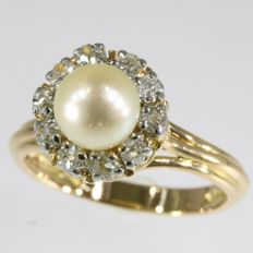 Fifties diamond pearl engagement ring