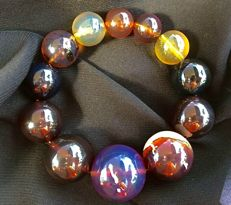 Multicolour untreated Amber multisize bracelet with central big deep Blue Amber eye & inclusions, over 48 grams