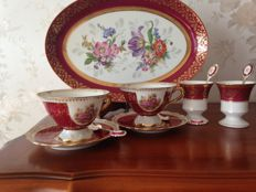 Limoges, France  Gilded porcelain  Exclusive and signed
