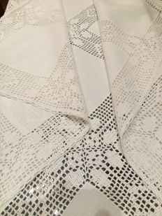 Handmade tablecloth with lace inlays.
